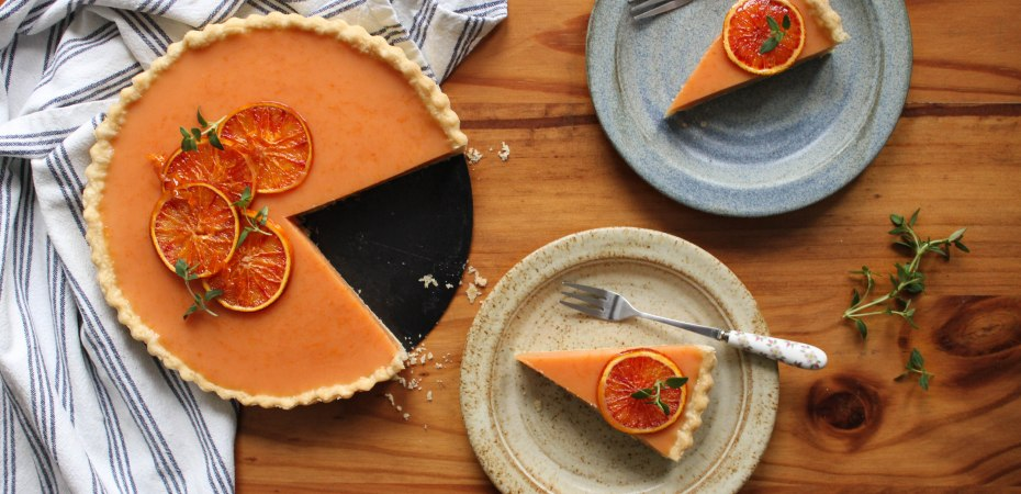 Vegan blood orange tart with two slices out